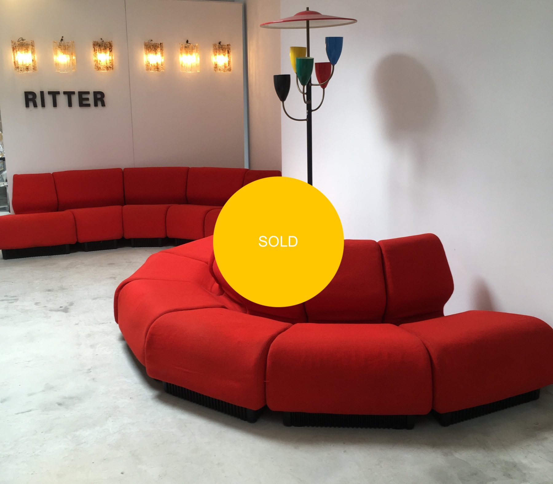 Red modular sofa by Don Chadwick for Herman Miller
