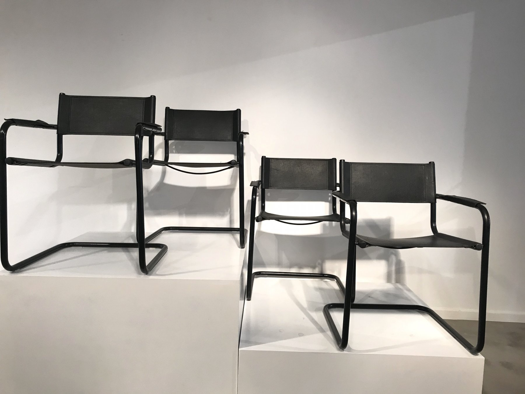 Set of 6 black leather chairs