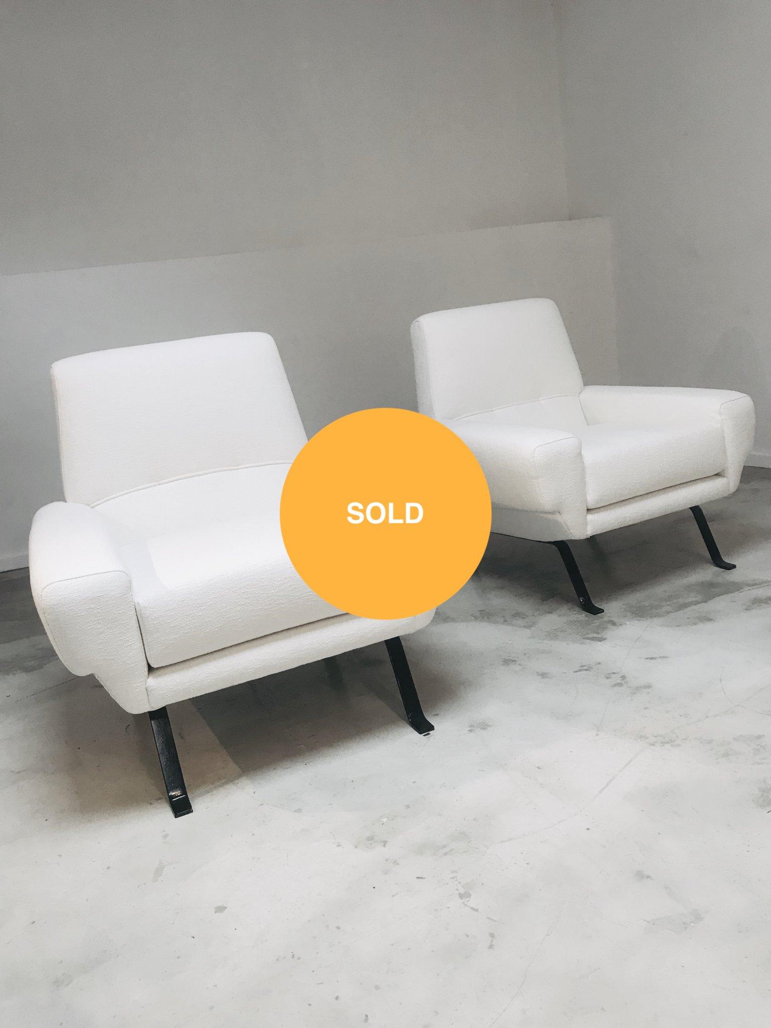 Pair of white easy chairs