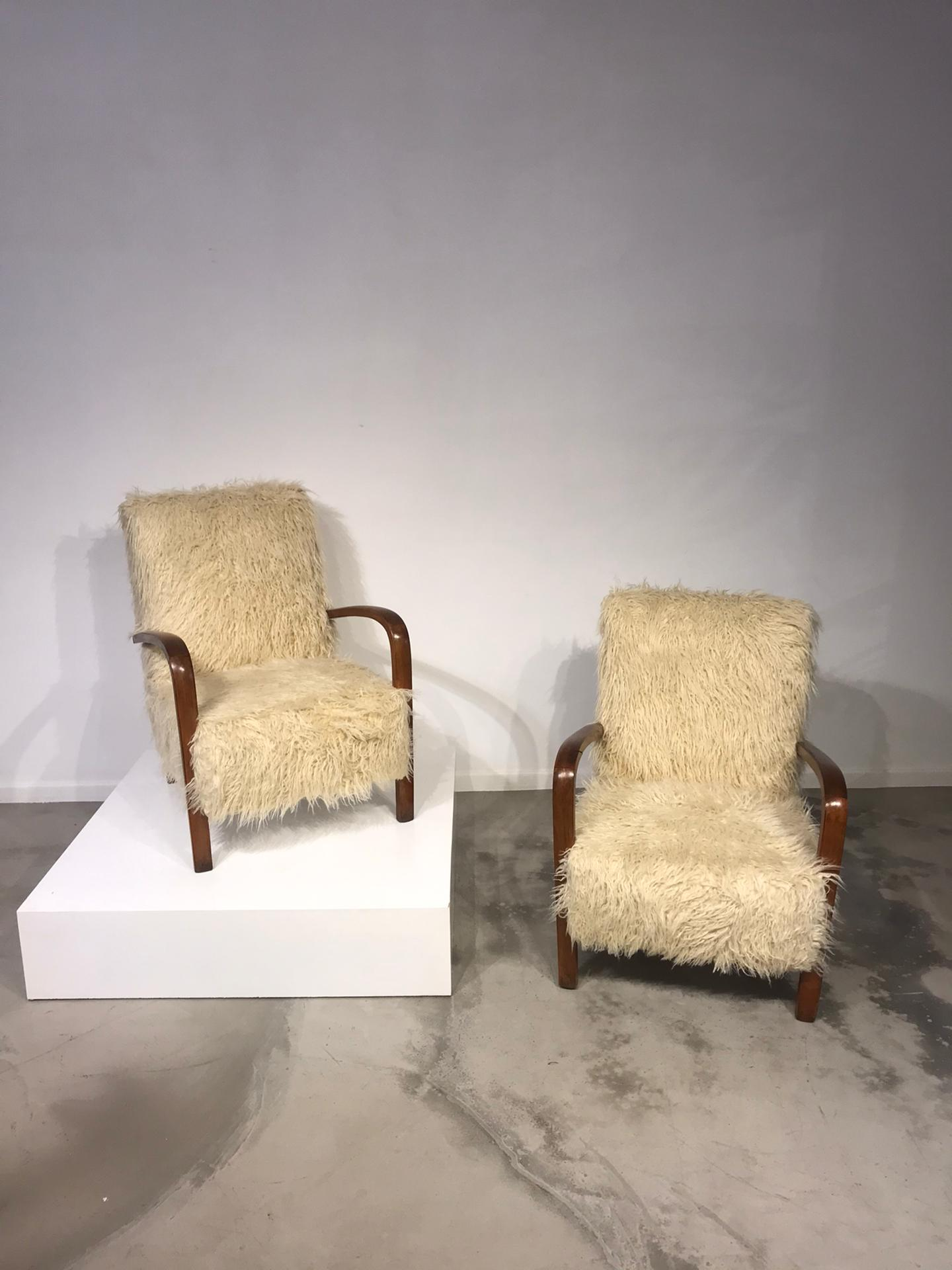 Pair of fur easy chairs